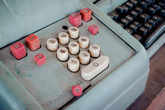 Old antique cash register, adding machines or antique calculate. In old convenience store Royalty Free Stock Images