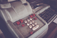 Old antique cash register, adding machines or antique calculate. In old convenience store Royalty Free Stock Photos