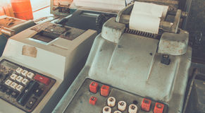 Old antique cash register, adding machines or antique calculate. In old convenience store Stock Photography