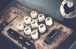 Old antique cash register, adding machines or antique calculate in old convenience store. Stock Photography
