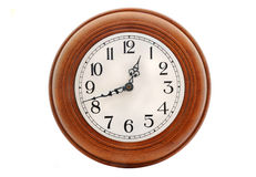 Old antique clock isolated. Wooden old clock isolated on a white background Stock Photo