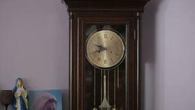 Old antique clock with statuette of the Virgin Mary stock video