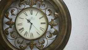 Old antique clock on the wall stock video footage