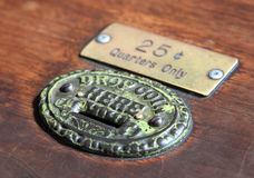 Old antique coin slot Royalty Free Stock Photography