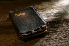 Old Antique Damaged Holy Bible Sacred Book on Wood Royalty Free Stock Image