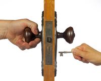 Old antique door being open with skeleton key. Stock Images