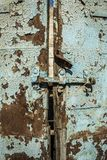Old antique door with chipped paint and rusted lock. Stock Photos