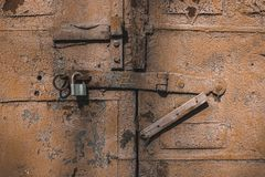 Old antique door with chipped paint and rusted lock. Stock Photo