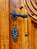 Old antique door handle. Old wood door with antique metal handle and keyhole Royalty Free Stock Photo