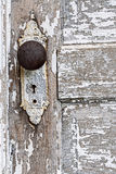 Old antique door knob and pealing white paint background Royalty Free Stock Photos