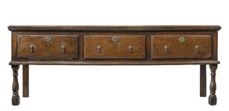 Old antique dresser base. Original early English oak dresser base serving table isolated with clip path royalty free stock photo