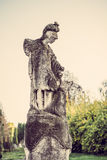 Old antique female sculpture with sky and trees on background Royalty Free Stock Photography