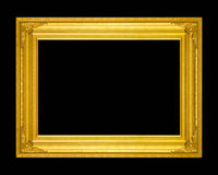 Old antique gold frame isolated on a black background. Stock Images