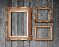 Old antique gold frame on wood texture background Stock Image