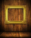 Old antique gold frame on wood wall Stock Image
