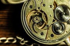 Old antique gold pocket watch with chain. Close up, open back concept. Royalty Free Stock Photos