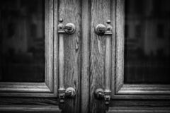 Old Antique Handles On Wooden Entrance Door. Handles On Wooden Door. Black And White Background. Old Antique Handles On Wooden Entrance Door. Handles On Wooden stock photo