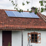Old antique house with solar panels Stock Photo
