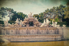 Old antique image of Neptune fountain in Schonbrunn Palace in Vienna Stock Images