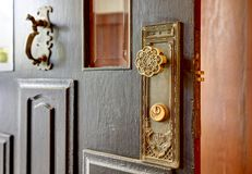 Old antique key lock door know details. Northwest, USA Stock Image