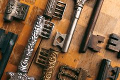 Old antique keys on a chessboard.  Royalty Free Stock Photography