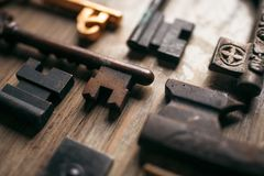 Old antique keys close-up on a wooden background.  Stock Photography
