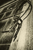 Old antique keys and ring against leaded window Royalty Free Stock Image