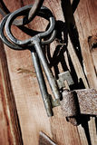 Old antique keys and ring against wood Royalty Free Stock Image