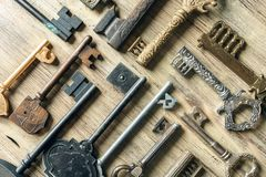 Old antique keys on a wooden background.  Stock Photo