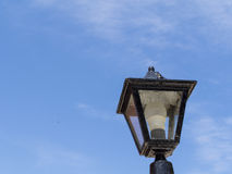 Old antique lamppost. The lantern of an antique lamppost against blue sky Stock Photography