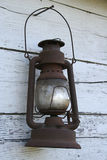 Old antique lantern. Old rusted antique lantern hanging on barn wood Royalty Free Stock Photography