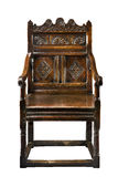 Old antique oak wainscot chair with carving isolated on white Stock Photography