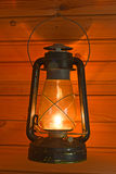 Old antique oil lantern. On woode wall Royalty Free Stock Images