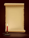 Old antique paper manuscript with candle Stock Photo