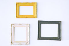 Old antique picture frame on wall. Vintage style decorate Royalty Free Stock Images