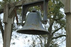 Historic School Bell. Old Antique School Bell Children Ring Teacher Classroom Historic One Room School House Outdoors Steel Time Class Education Math Reading Stock Photography