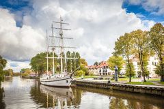 Old antique ship in the Danes Bay canale. KLAIPEDA / LITHUANIA - OCTOBER 12, 2016: Old antique ship in the Danes Bay canale stock images