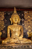 Old antique statue of Buddha in a temple room. Thailand Royalty Free Stock Images