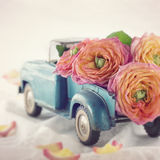 Old antique toy truck carrying a roses royalty free stock photography