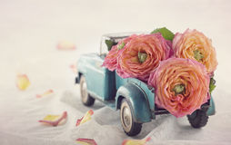 Old antique toy truck carrying a roses royalty free stock photo