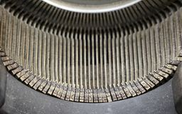 Old antique typewriter typeface. Close up old vintage antique retro typewriter with Latin typeface, high angle view Royalty Free Stock Image