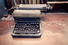 Old antique typewriter. Vintage typewriter placed on the desk. Color-toning applied Royalty Free Stock Photos