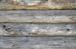 Old antique unpainted wooden logs wall texture Royalty Free Stock Image