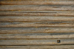Old antique unpainted wooden logs wall texture Stock Image