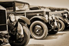 Vintage cars, sepia. Old antique vintage cars, sepia colors stock photo