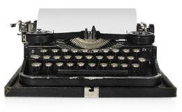Old antique vintage portable typewriter, with a blank sheet of p Stock Photography