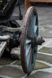 An old antique wagon wheel made of wood and metal.  Royalty Free Stock Images