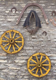 Old Antique Wagon Wheels, Harness andHorseshoe Stock Images