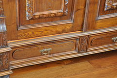 Old antique wardrobe with drawers. On the wooden floor Royalty Free Stock Photo