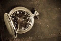 Old antique watch. On brown leather background Stock Photo